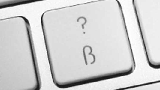 Computer key with question mark