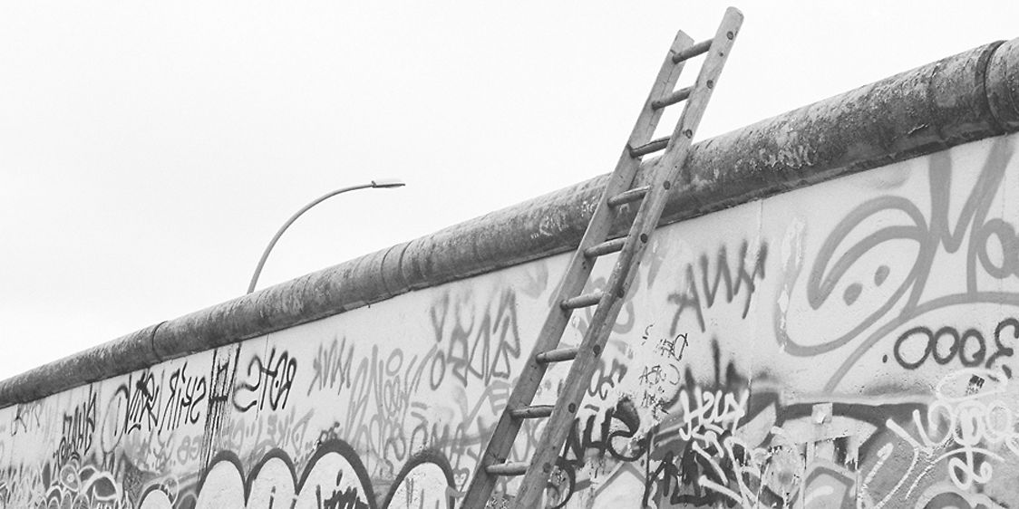 Berlin wall with ajar ladder