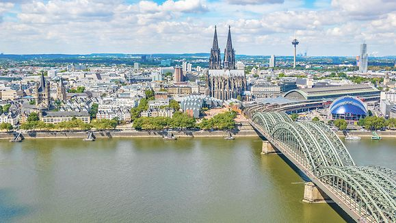 Federal State North Rhine-Westphalia, Germany - Aerial view of cityscape of Cologne with Hohenzollern bridge, cathedral and Saint Martin church.