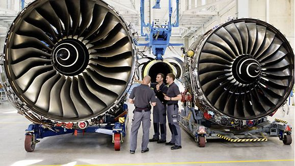 Technicians work on an aircraft engine at N3 Engine Overhaul Services on the Erfurter Kreuz industrial estate, Thuringia.