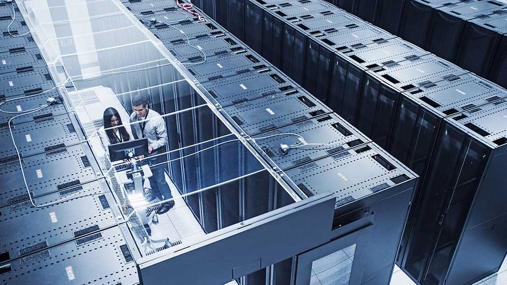 High angle view of technicians working in server room.