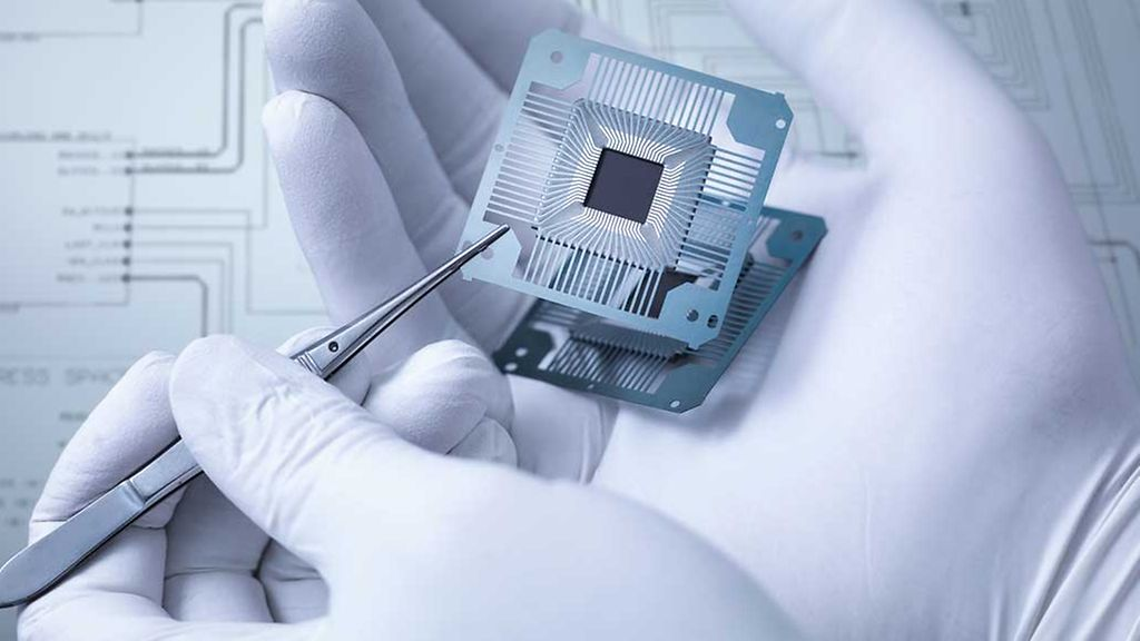Electronic components held in hand in laboratory, close up